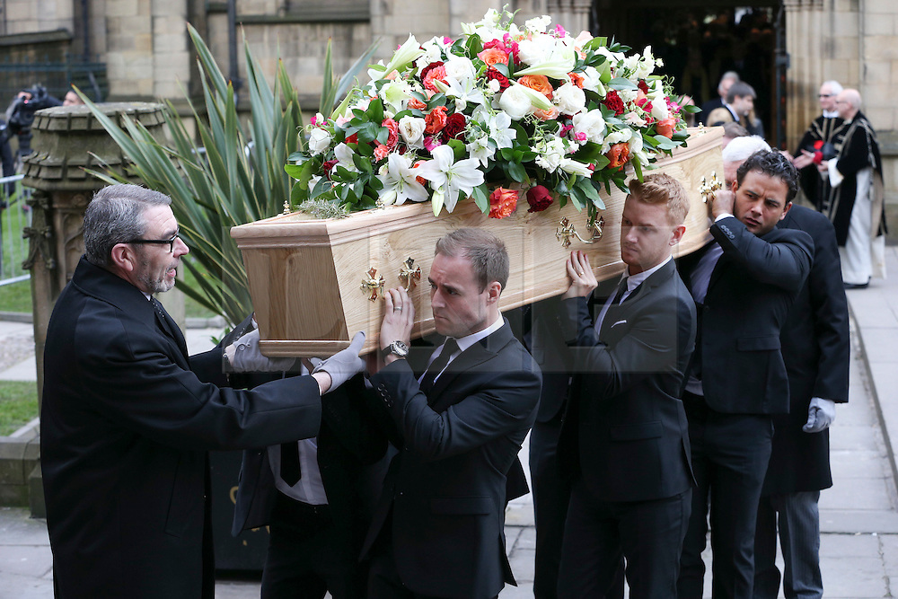 © Licensed to London News Pictures . 18/03/2016 . Manchester , UK . L to R Alan Halsall, Mikey North and Ryan Thomas carrying the coffin from the church following the service. Television stars and members of the public attend the funeral of Coronation Street creator Tony Warren at Manchester Cathedral . Photo credit : Joel Goodman/LNP