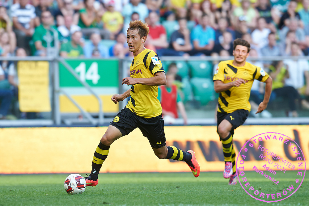 Dong-Won Ji of Dorussia Dortmund controls the ball during international friendly soccer match between WKS Slask Wroclaw and BVB Borussia Dortmund on Municipal Stadium in Wroclaw, Poland.<br /> <br /> Poland, Wroclaw, August 6, 2014<br /> <br /> Picture also available in RAW (NEF) or TIFF format on special request.<br /> <br /> For editorial use only. Any commercial or promotional use requires permission.<br /> <br /> Mandatory credit:<br /> Photo by &copy; Adam Nurkiewicz / Mediasport