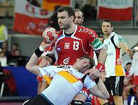 Handball EM Herren 2010 Vorrunde Deutschland - Polen 19.01.2010 Manuel Spaeth (GER vorne) gegen Bartosz Jurecki (POL)