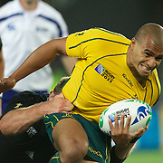 Will Genia, Australia, is tackled during the New Zealand V Australia Semi Final match at the IRB Rugby World Cup tournament, Eden Park, Auckland, New Zealand, 16th October 2011. Photo Tim Clayton...