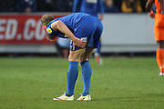 AFC Wimbledon midfielder Scott Wagstaff (7) holding his hamstring during the EFL Sky Bet League 1 match between AFC Wimbledon and Southend United at the Cherry Red Records Stadium, Kingston, England on 24 November 2018.