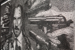 """He's nailed it. String artist Ben Koracevic creates these incredible works of art - using just cord and nails. The London-based creative winds thousands of metres of string around tens of thousands of nails to create what he calls 'stringometry'. Among his works are a huge portrait of Hollywood star Dwayne 'The Rock' Johnson and Keanu Reeves as his John Wick action hero character. He has also created a likeness of Batman baddie The Joker - as played by Joaquin Phoenix in 2019 movie, Joker, as well as animals including a lion and monkeys and guitarist Slash from Guns N' Roses. He only started doing 'string art' nine months ago after watching a video of someone else showing off their skills. """"I was completed fascinated with the rare art form,"""" he said. """"Developing my skill and ability to replicate what I witnessed became an obsession and I soon found every spare hour being invested into practising."""" The self-taught artist - who holds a science degree - has since quit his job and cashed in his life savings to follow his dream. He added: """"I am quite particular on the pieces I choose. """"It is just an instinct where I know the image will look good in string. """"It is a very time consuming process which is a quality I enjoy. I love the mental endurance and patience needed to complete a piece to high quality. """"Art is a universal language where the work does all the talking!"""" Ben uses a grid system overlapping a photo or sketch. He then upscales that on to a wooden canvas, before """"meticulously referencing"""" nails to mark a foundation and an outline for the string. He winds the string between the nails to create a likeness, using more string to create darker shadows and more detail. He has used between 6,000 and 30,000 nails on individual pieces - and some contain more than 3,000 metres of string. And he can spend as much as 500 hours alone creating one piece. His works are available to buy at stringometry.com and he is available for private commissions. Please credit Courtesy of"""