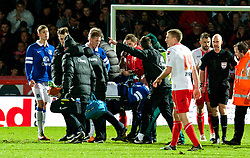 STEVENAGE, ENGLAND - Saturday, January 25, 2014: Everton's Bryan Oviedo is carried off injured during the FA Cup 4th Round match against Stevenage at Broadhall Way. (Pic by Tom Hevezi/Propaganda)