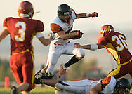NEWS&GUIDE PHOTO / PRICE CHAMBERS.Jackson senior running back Alex Bush hurdles a fallen lineman as he scrambles for a short gain against Star Valley on Friday night. Jackson won the game 24-7.