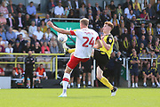 Burton Albion midfielder Stephen Quinn (7) and Rotherham United forward Michael Smith (24) during the EFL Sky Bet League 1 match between Burton Albion and Rotherham United at the Pirelli Stadium, Burton upon Trent, England on 17 August 2019.