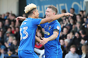 AFC Wimbledon striker Lyle Taylor (33) and AFC Wimbledon striker Cody McDonald (10) celebrating after AFC Wimbledon striker Cody McDonald (10) scored during the EFL Sky Bet League 1 match between AFC Wimbledon and Peterborough United at the Cherry Red Records Stadium, Kingston, England on 12 November 2017. Photo by Matthew Redman.