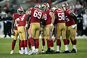 The San Francisco 49ers offense huddles and calls a play during the NFL week 9 regular season football game against the Oakland Raiders on Thursday, Nov. 1, 2018 in Santa Clara, Calif. The 49ers won the game 34-3. (©Paul Anthony Spinelli)