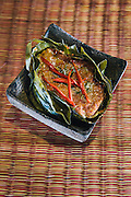 Steamed fish curry in banana leaves (amok) prepared by Khetana Dunnet owner of Sugar Palm restaurant, Siem Reap