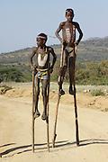 Africa, Ethiopia, Konso tribe children on stilts