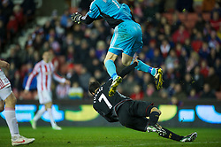 STOKE-ON-TRENT, ENGLAND - Boxing Day Wednesday, December 26, 2012: Liverpool's Luis Alberto Suarez Diaz challenges Stoke City's goalkeeper Asmir Begovic during the Premiership match at the Britannia Stadium. (Pic by David Rawcliffe/Propaganda)