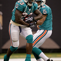 2009 September 03: Miami Dolphins quarterback Pat White (6) hands off to running back Ronnie Brown (23) during warm ups before a preseason game between the Miami Dolphins and the New Orleans Saints at the Louisiana Superdome in New Orleans, Louisiana.