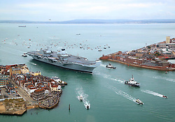 Review of the Year 2017: August: The 65,000-tonne HMS Queen Elizabeth, the UK's newest aircraft carrier and the largest warship ever to be built in Britain, which is expected to be the Navy's flagship for at least 50 years, arrives in Portsmouth.