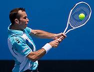 Radek Stepanek (CZE) [13]<br /> 2010 Australian Open Tennis<br /> Mens Singles<br /> First Round<br /> 18/01/10<br /> Radek Stepanek of the Czech Republic hits a backhand return during his first round match against Ivo Karlovic of Croatia<br /> &quot;Court 6&quot; Melbourne Park, Melbourne, Victoria, Australia<br /> Photo By Lucas Wroe
