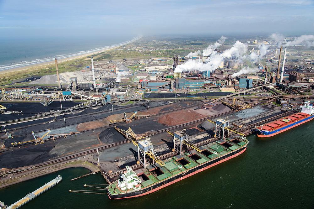 Nederland, Noord-Holland, IJmuiden , 09-04-2014; IJmuiden Steel Works van Tata Steel. Genco Augustus voor de wal bij de ertsopslag en de cokesfabriek.<br /> IJmuiden Steel Works, part of Tata Steel. <br /> luchtfoto (toeslag op standard tarieven);<br /> aerial photo (additional fee required);<br /> copyright foto/photo Siebe Swart