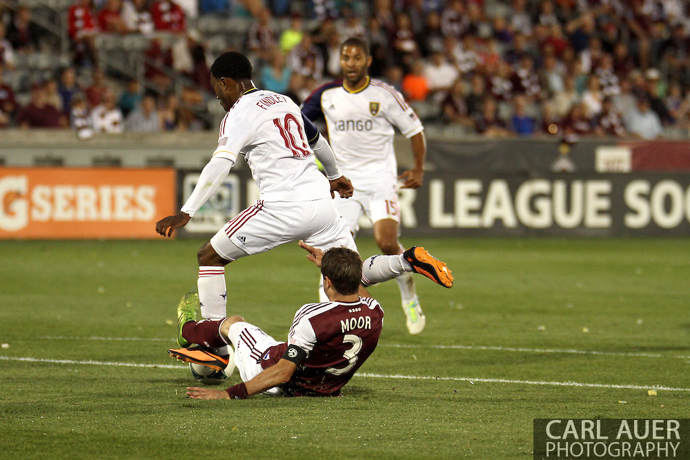 August 3rd, 2013 - Colorado Rapids defender Drew Moor (3) fouls Real Salt Lake forward Robbie Findley (10) in the penalty area right before a first half lightning delay in the Major League Soccer match between Real Salt Lake and the Colorado Rapids at Dick's Sporting Goods Park in Commerce City, CO