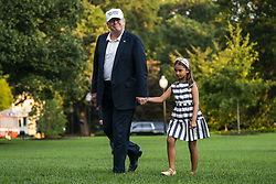U.S. President Donald J. Trump (L) and his granddaughter Arabella Rose Kushner (R) walk across the South Lawn as they return from a weekend stay in Bedminster, New Jersey at the White House in Washington, DC, USA, 29 July 2018. Earlier in the day, the President once again went after the media on Twitter, calling them the 'enemy of the people.'