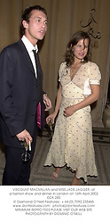 VISCOUNT MACMILLAN and MISS JADE JAGGER, at a fashion show and dinner in London on 16th April 2002.	OZA 280