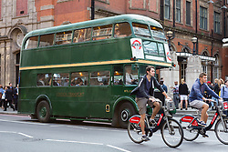 © Licensed to London News Pictures. 08/07/2015. London, UK. A green routemaster bus is seen passing Liverpool Street station in London this evening and is one of the additional special service busses that are being provided during the tube strike. London transport workers begin strike action tonight, which will continue tomorrow. Photo credit : Vickie Flores/LNP