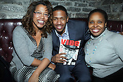 l to r: Danyel Smith, Nick Cannon and Olivia Scott-Perkins at The Vibe Magazine private reception in honor of Grammy Award winning Superstar artist and actor, T.I held at The Eldrige on February 9, 2009 in New York City