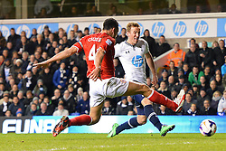 Cardiff's Steven Caulker and Tottenham's Harry Kane  compete for the ball - Photo mandatory by-line: Mitchell Gunn/JMP - Tel: Mobile: 07966 386802 02/03/2014 - SPORT - FOOTBALL - White Hart Lane - London - Tottenham Hotspur v Cardiff City - Premier League