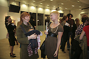 Sarah Andrew with baby Cora and Julia Hansson. Henry Hudson opening. Hiscox Projects. 1 Gt. St. Helen St. London. 22 February 2007.  -DO NOT ARCHIVE-© Copyright Photograph by Dafydd Jones. 248 Clapham Rd. London SW9 0PZ. Tel 0207 820 0771. www.dafjones.com.