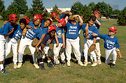 12 year old inner city baseball team goofing off during practice.  St Paul  Minnesota USA