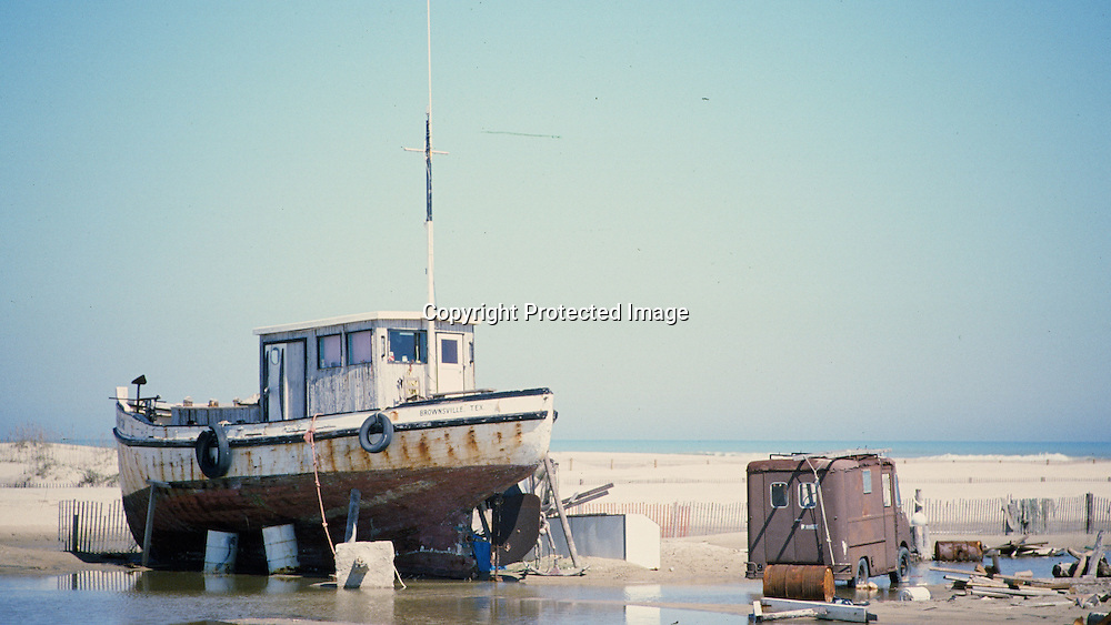 """Old boat turned into home on Padre Island in Texas. NOTE: Click """"Shopping Cart"""" icon for available sizes and prices. If a """"Purchase this image"""" screen opens, click arrow on it. Doing so does not constitute making a purchase. To purchase, additional steps are required."""
