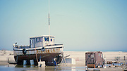 "Old boat turned into home on Padre Island in Texas. NOTE: Click ""Shopping Cart"" icon for available sizes and prices. If a ""Purchase this image"" screen opens, click arrow on it. Doing so does not constitute making a purchase. To purchase, additional steps are required."