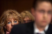 """Charlie Smith looks on as her son Trevor Schaefer, youth ambassador and founder of Trevor's Trek Foundation testifies during an Environment and Public Works Committee hearing on """"Disease Clusters and Environmental Health."""""""