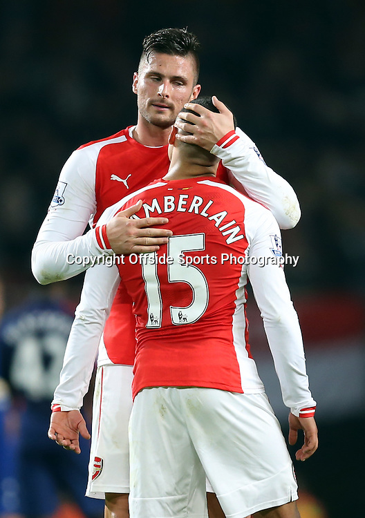 22 November 2014 - Barclays Premier League - Arsenal v Manchester United - Olivier Giroud of Arsenal comforts a dejected Alex Oxlade-Chamberlain - Photo: Marc Atkins / Offside.
