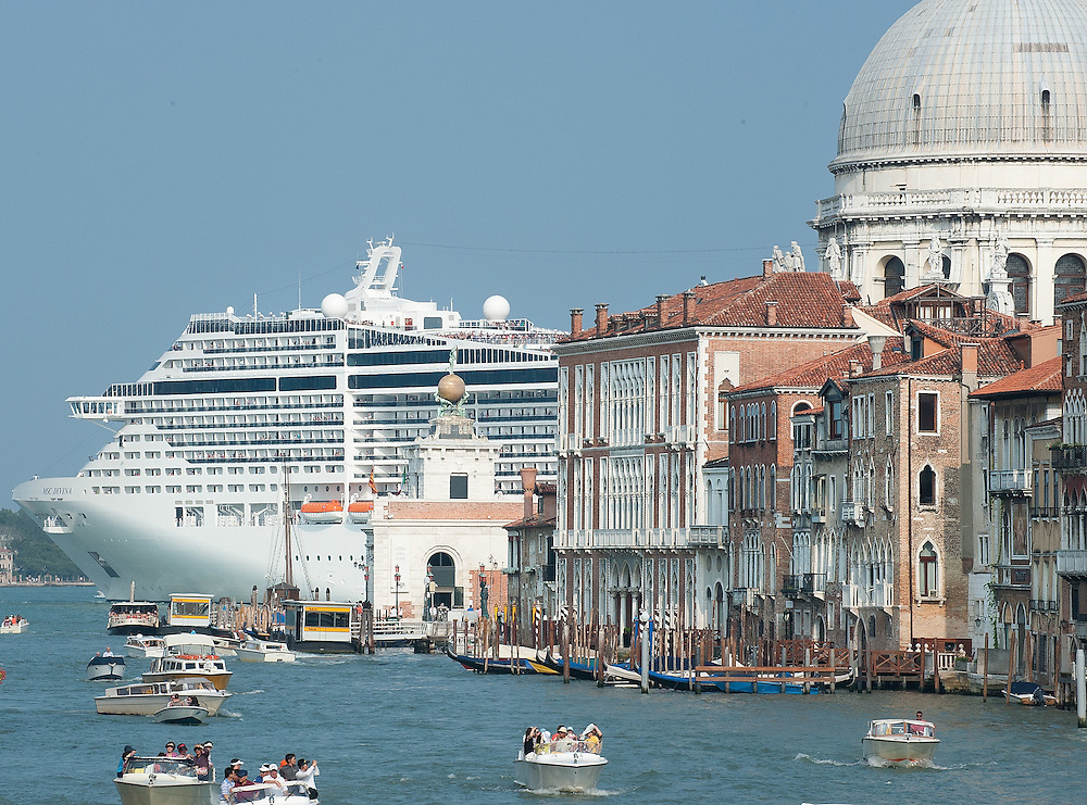 VENICE, ITALY - JUNE 02:  MSC Divina leaves Venice by St Mark's Basin after just few hours stop on June 2, 2012 in Venice, Italy. At 139, 000 tons, the MSC Divina can carry nearly 4,000 passengers. FAI (Fonto Ambientale Italiano) is now supporting Venetians and environmentalists in their protetst against cruise ships sailing in St Mark's basin, arguing that the increased boat traffic on Venice's waterways increases pollution and damages property.  (Photo by Marco Secchi/Getty Images)