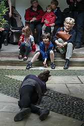 © Licensed to London News Pictures. 23/07/2012. London, UK.  Performers from the Without Warning Company perform a 15 minute sound and movement installation reflecting the passage of time. The piece was choreographed by Lizzi Kew Ross and was performed in the grounds of St. Vedast Church near St Paul's Cathedral in London on the 23rd June 2012. Photo credit : Tony Nandi/LNP