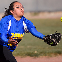 032914       Cable Hoover<br /> <br /> Zuni Thunderbird Keisha Lonjose (23) gets her glove under an infield popup from the Miyamura Patriots Saturday at Tohatchi High School.