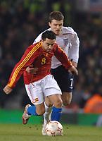 Photo: Paul Greenwood.<br />England v Spain. International Friendly. 07/02/2007. Spains Xavier Hernandez holds off Englands Michael Carrick