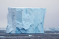 Tabular iceberg in iceberg alley in Antarctic Sound in Antarctica.