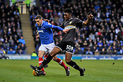 Portsmouth Midfielder, Stuart O'Keefe (7) and Bury Midfielder, Rohan Ince (30) during the EFL Sky Bet League 1 match between Portsmouth and Bury at Fratton Park, Portsmouth, England on 16 December 2017. Photo by Adam Rivers.