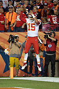 Kansas City Chiefs quarterback Patrick Mahomes (15) leaps and celebrates with an apparent free throw after running for a 14 yard touchdown good for a 10-3 Chiefs lead in the second quarter during the NFL week 4 regular season football game against the Denver Broncos on Monday, Oct. 1, 2018 in Denver. The Chiefs won the game 27-23. (©Paul Anthony Spinelli)
