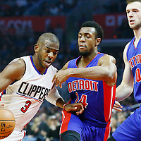 07 November 2016: Los Angeles Clippers guard Chris Paul (3) drives past Detroit Pistons guard Ish Smith (14) and Detroit Pistons center Andre Drummond (0) during the LA Clippers 114-82 victory over the Detroit Pistons, at the Staples Center, Los Angeles, California, USA.
