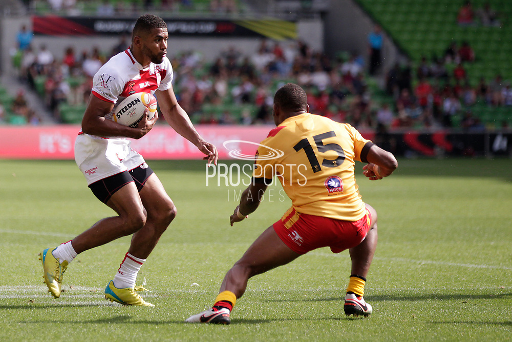 Kallum Watkins of England goes to dance around Stargroth Amean of Papua New Guinea during the Rugby League World Cup Quarter-Final match between England and  Papua New Guinea at Melbourne Rectangular Stadium, Melbourne, Australia on 19 November 2017. Photo by Mark  Witte.