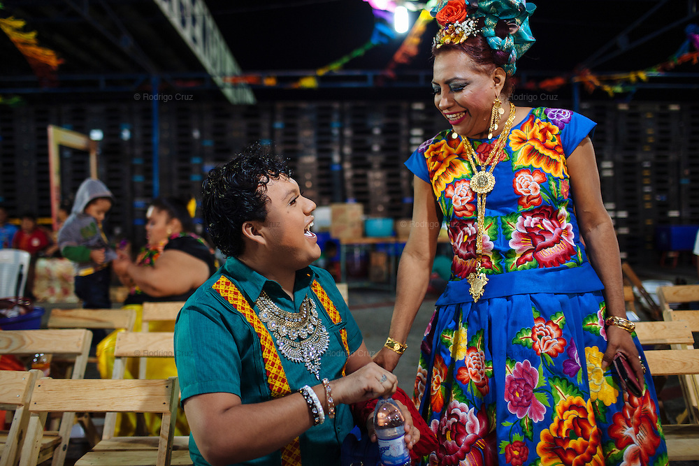 "Angelo Martinez Linares, 24, during the annual party known as the Muxe Candle in Juchitán, Mexico.<br /> <br /> In Juchitán in the southern state of Oaxaca, Mexico, the world is not divided simply into gay and straight, the locals make room for a third category, whom they call ""muxes"".<br /> <br /> Muxes are men who consider themselves women and live in a socially sanctioned netherworld between the two genders. ""Muxe"" is a Zapotec word derived from the Spanish ""mujer"" or woman; it is reserved for males who, from boyhood, have felt themselves drawn to living as a woman, anticipating roles set out for them by the community.<br /> <br /> They are considered hard workers that will forever stay by their mothers side, taking care for their families operating as mothers without children of their own.<br /> <br /> Not all muxes express they identities the same way. Some dress as women and take hormones to change their bodies. Others favor male clothes. What they share is that the community accepts them."