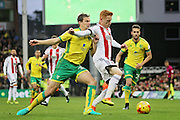Brentford midfielder Ryan Woods (15) is ushered away from goal by Norwich City defender Ryan Bennett during the EFL Sky Bet Championship match between Norwich City and Brentford at Carrow Road, Norwich, England on 3 December 2016. Photo by Nigel Cole.