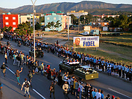 The caravan carrying the ashes of Cuban leader Fidel Castro approach Santa Ifigenia cemetary, Castro's final resting place in Santiago de Cuba on Sunday, December 4, 2016.