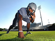 Norcorss defensive end, J.B. Kouassi, stands in for a portrait on Wednesday at Norcross High School. Kouassi is a key returning member to a strong Blue Devils' defensive line that is looking for its third straight state championship. (Staff Photo: David Welker)