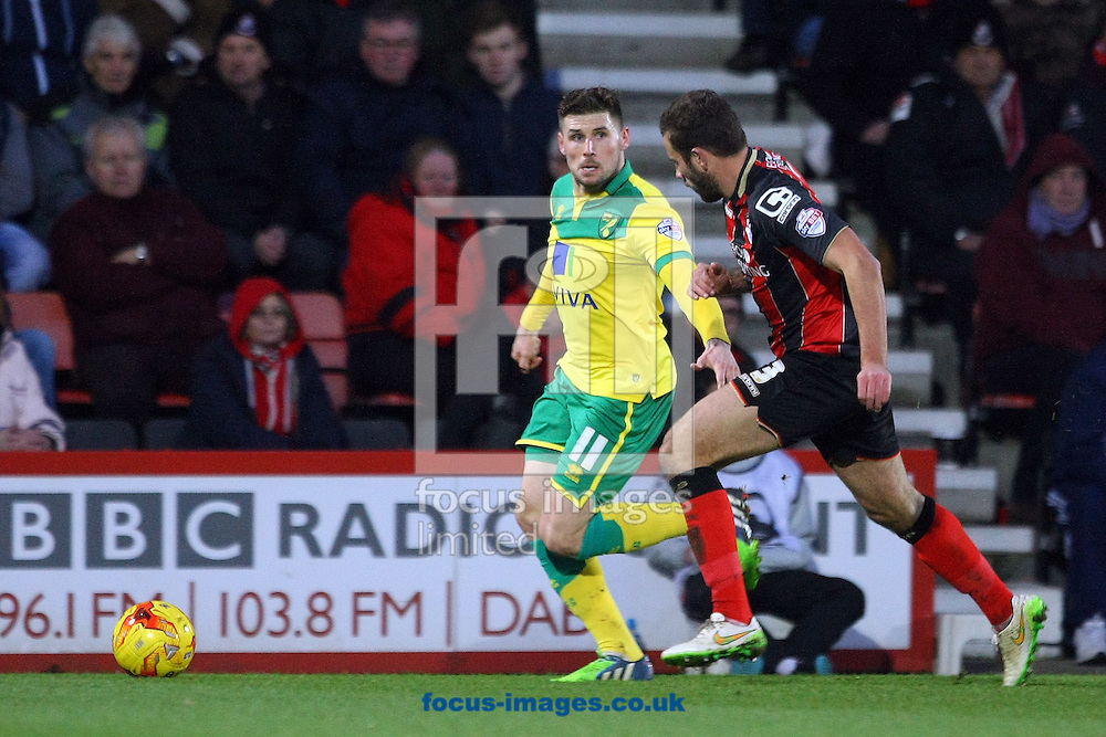 Gary Hooper of Norwich and Steve Cook of Bournemouth in action during the match at the Goldsands Stadium, Bournemouth<br /> Picture by Paul Chesterton/Focus Images Ltd +44 7904 640267<br /> 10/01/2015