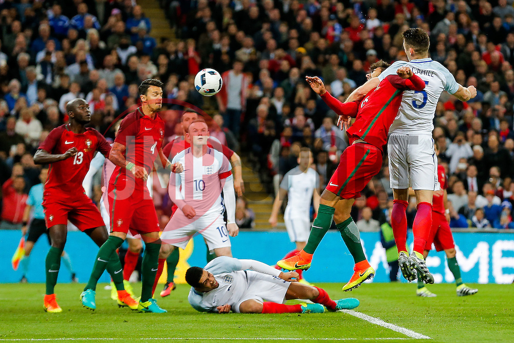Andre Gomes of Portugal and Gary Cahill of England compete in the air - Mandatory byline: Rogan Thomson/JMP - 02/06/2016 - FOOTBALL - Wembley Stadium - London, England - England v Portugal - International Friendly.