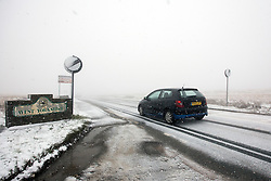 © Licensed to London News Pictures. 09/02/2016. Saddleworth Moor UK. Drivers are facing treacherous conditions on Saddleworth Moor in Yorkshire this afternoon as snow has hit the County. Photo credit: Andrew McCaren/LNP