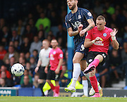 Peterborough United player Marcus Maddison gets the better of Southend player Anthony Wordsworth during the Sky Bet League 1 match between Southend United and Peterborough United at Roots Hall, Southend, England on 5 September 2015. Photo by Bennett Dean.