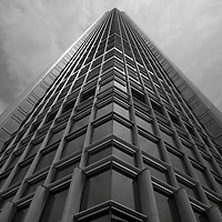 Asia, Peoples Republic of China, Hong Kong, Black and white  view looking up at steel and glass exterior of IFC 2 Building (International Finance Centre)