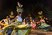 Costumed dancers at a Comparsa, or parade during the Day of the Dead Festival known in spanish as Día de Muertos on October 31, 2014 in Oaxaca, Mexico.