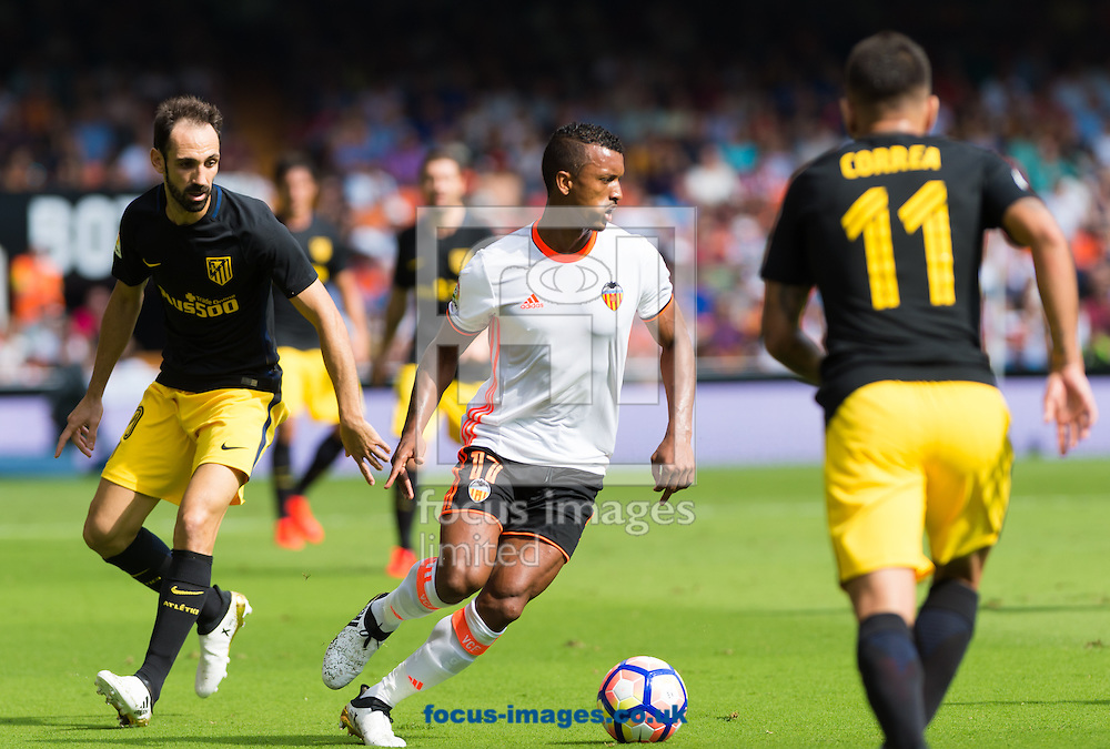 Luis Nani of Valencia CF and Juanfran Torres of Atletico Madrid during the La Liga match at Mestalla, Valencia<br /> Picture by Maria Jose Segovia/Focus Images Ltd +34 660052291<br /> 02/10/2016
